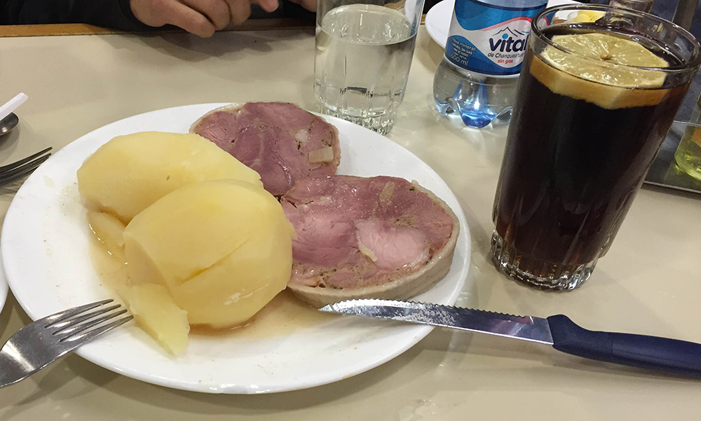 Lunch, piscola with meat.